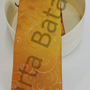 Corbata de seda con tonos dorados y círculos